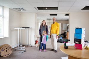 Members of the residents' group of the Abolish Empty Office Buildings campaign, Alice Kershaw (6) Elinor Kershaw and James Deane, take a look at the first office property the group is going to buy in St George, Bristol, for conversion to a social housing co-operative.